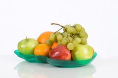 Green platter of mixed fresh fruit. Display Royalty Free Stock Photography