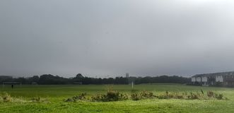 Playing Fields. The green playing fields of Wigan looking towards the parish church on the horizon Royalty Free Stock Images