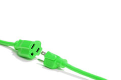 Green Plug isolated on white in the studio Royalty Free Stock Photo