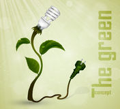 Green plug with leaves and planet Stock Photo