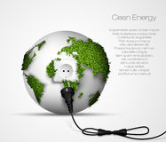 Green plug with leaves and planet. Stock Image
