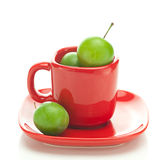 Green plum in the cup Stock Photo
