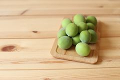 Plum fruits on wooden table. Green plum fruits on wooden table stock images