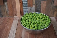 Green plum on wood board Stock Photography