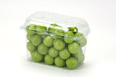 Green plums(greengages) in a plastic box Stock Images