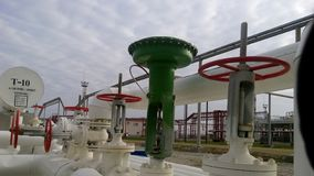 Green pneumatic valve on the pipeline. The equipment of the oil plant stock photo
