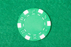 Green poker chip on the casino table Royalty Free Stock Photography