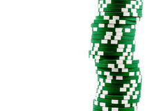 Green poker chips stacked in a line Stock Photo