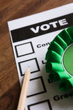 Green Political Rossette On Ballot Paper For Election Royalty Free Stock Photography