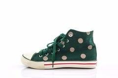Green polka dot canvas shoe. Royalty Free Stock Photos