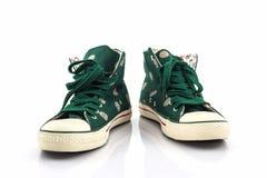 Green polka dot canvas shoe. Stock Photos