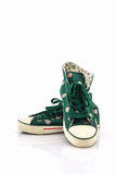 Green polka dot canvas shoe. Royalty Free Stock Image