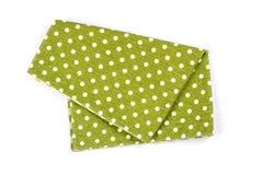 Green polka dot checkered napkin table clothes  on white backgro. A green polka dot checkered napkin table clothes  on white background Royalty Free Stock Photography