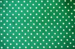 Green polka dot fabric. In full frame Royalty Free Stock Image
