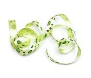 Green polka dot fabric ribbon. On the white Royalty Free Stock Photography