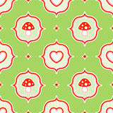 Green polka dot pattern with red toadstool mushroo Stock Photography