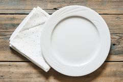 Green polka dot towel and empty white plate. Top view with copy. Closeup empty white plate on colorful polka dot background.Top view with copy space royalty free stock photos