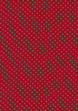Green polka dot vintage pattern on red cloth textu Stock Images