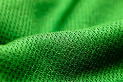 Green polyester. Close up of green polyester material Stock Photo