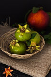 Green pomegranate in basket closeup background Royalty Free Stock Images