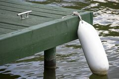 green pontoon buoy royalty free stock photo