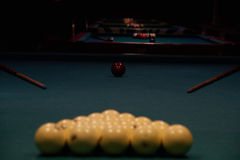 Green pool tables with cues. Pool tables prepared for the games royalty free stock image