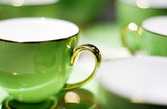 Green porcelain. Green china cups ,with golden gripes Royalty Free Stock Photo