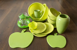 Green porcelain dishes on a dark wood floor Stock Image