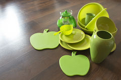 Green porcelain dishes on a dark wood floor Royalty Free Stock Photos
