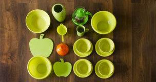 Green porcelain dishes top view with an orange plastic funnel Stock Photos