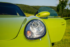 Green Porsche Boxster sports car front view close up Stock Photos