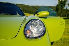 Green Porsche Boxster sports car front view close up. Detail of front view on green Porsche Boxster stock photos