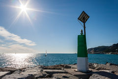 Green port signal. Green port signar in a sunny day Stock Images