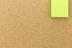Green post it on cork board Stock Images