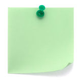 Green post-it note. Pinned on a pure white background. Waiting for your message Royalty Free Stock Images