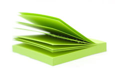 Green post it note sticky memo pad. On a white background Stock Images
