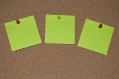 Green Post it Notes on a Cork Board Royalty Free Stock Photography