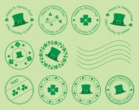 Green postage stamps with clovers and hat for saint patrick day Stock Photos
