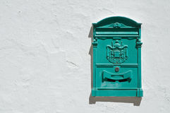 Green postbox. Close up of a green postbox Royalty Free Stock Photos