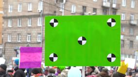 Green poster 4k. People at the demonstration with banners in their hands. stock video footage