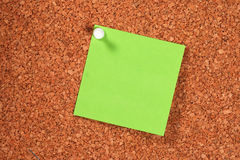 Green Postit. Photo of Green Postit Tacked To Cork Boad Royalty Free Stock Photo