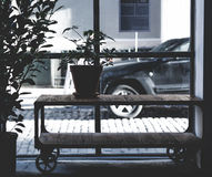 Green Potted Plant on Brown Wooden Table Across Black Car during Daytime Stock Photos