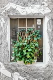 Green Potted Plant on Grafitti Character Wall Stock Images