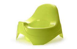 Green potty. Toilet training chamber pot for small children royalty free stock photography