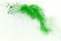 Green powder explosion on white background. Colored cloud. Color dust explode. Paint Holi. royalty free stock image
