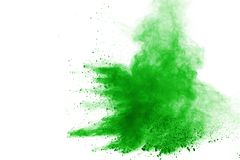Green powder explosion on white background. Colored cloud. Color dust explode. Paint Holi. stock photography