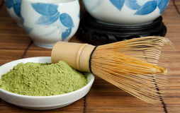 Green powder tea and whisk Royalty Free Stock Photography
