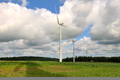 Green Power. Green wind power in a field of corn stock photos