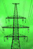 Green power. The silhouette of power lines agains a green sky Royalty Free Stock Photography