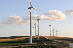 Green power 2. Wind turbines with blue sky and clouds Stock Photography